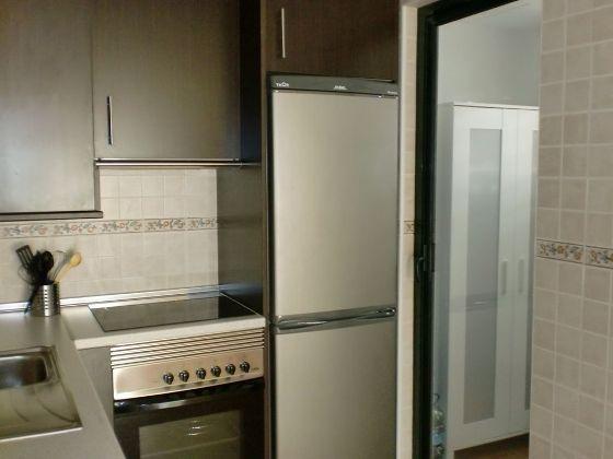 Küche-mit-angrenzendem-Hauswirtschaftsraum_Cala-Millor_op-01-1